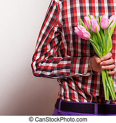 loving couple - man with rose waiting his woman. Valentine's Day