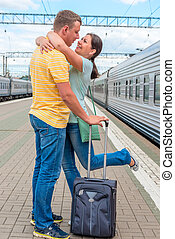loving couple meeting at the railway station