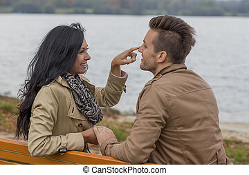 loving couple on a bench - a young, laughed liebtes couple...