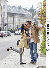 loving couple on a city stroll - a young couple strolling...