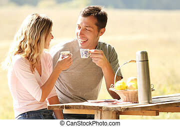 Loving couple on a picnic