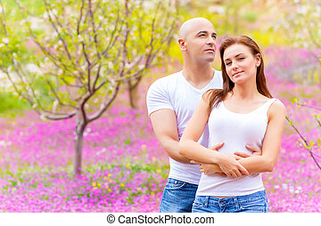 Loving couple on floral field