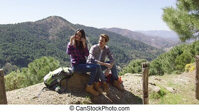 Loving couple on rest in mountains - Young man and woman...