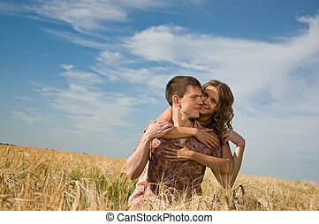 Loving couple on wheat field