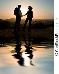Loving couple outdoors - Couple silhouette outdoors,...