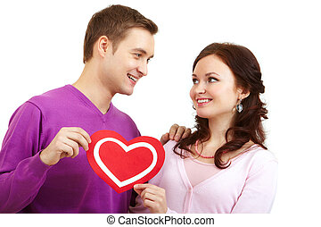 Loving couple - Portrait of a young beautiful couple holding...