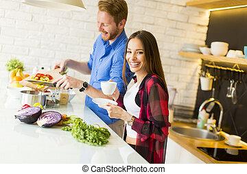 Loving couple preparing healthy food