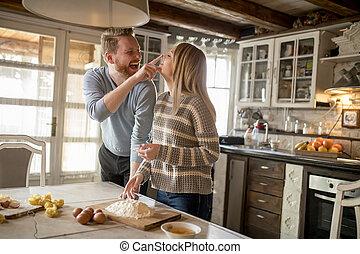 Loving couple preparing pasta in the kitchen