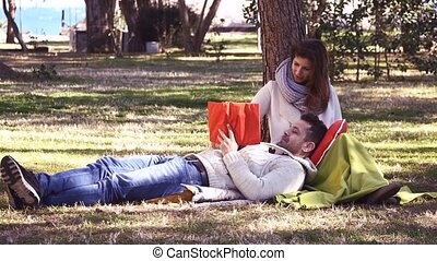 Loving couple reading a book