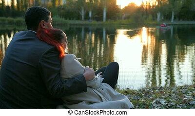 Loving couple resting in autumn