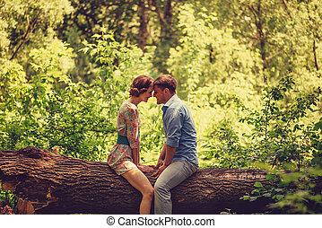 Loving couple resting in summer park
