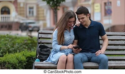 Loving couple sharing media content on smartphone