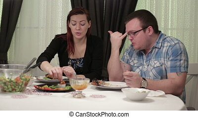 Loving couple sitting at a dinner table in a cafe