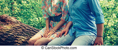 Loving couple sitting on tree