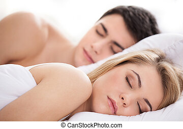 Loving couple sleeping. Beautiful young loving couple ...
