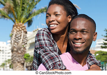 Loving couple smiling together outdoors