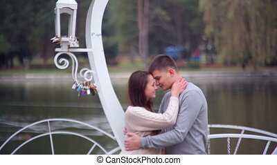loving couple standing in gazebo - loving couple standing in...