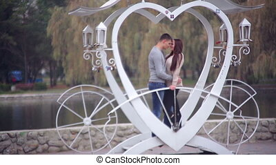 loving couple standing in gazebo