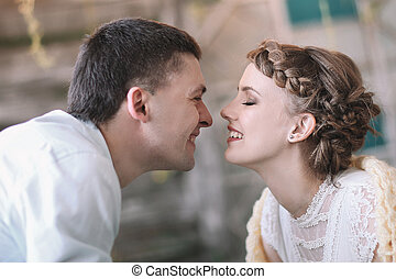loving couple teasing each other in a stylish living room