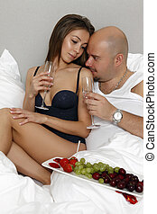 Loving couple tenderly embracing - Loving couple in bed...