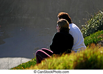 Loving couple - They were sitting at a distance watching the...