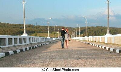 loving couple walking along  road