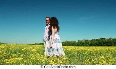 Loving couple walking in field
