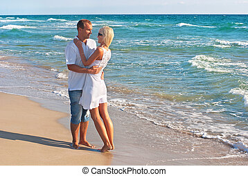 loving couple walking on sea beach