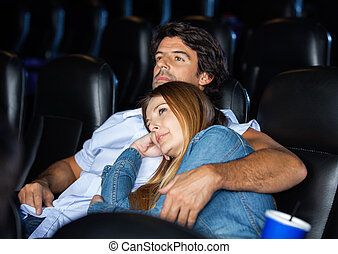 Loving Couple Watching Movie In Theater