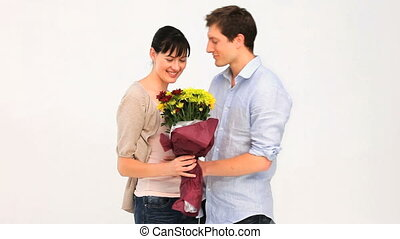 Loving couple with a bunch of flowers