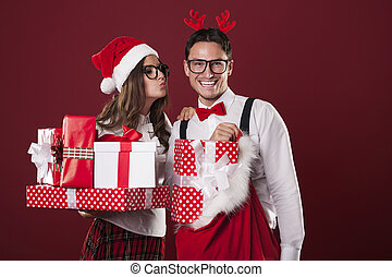 Loving couple with a lot of christmas gifts