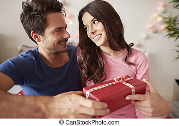 Loving couple with Christmas present