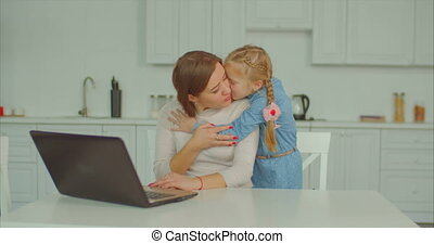 Loving daughter embracing her workaholic mother -...