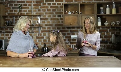 Loving daughter embracing mother in the kitchen