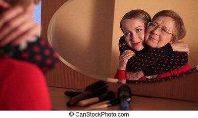 Loving daughter hugging mother with tenderness