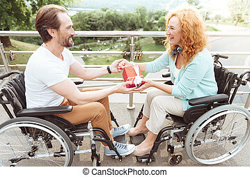Loving disabled couple celebrating anniversary outdoors