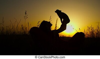 Loving dog owner holding doggy in evening glow - Silhouette ...