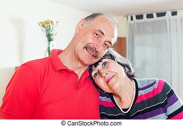 loving elderly couple in home