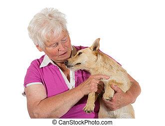 Loving elderly woman with her dog - Loving elderly woman...