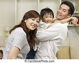 loving asian family having fun at home.