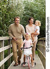 Loving family on small bridge in the park