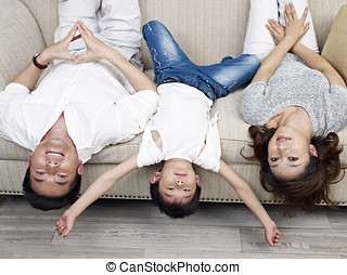 loving family - mother, father and son having fun at home.