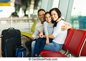 loving family waiting at airport - loving young family...