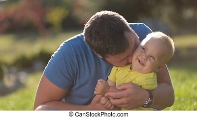 Loving father and toddler boy having fun outdoors