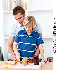 Loving father helping his son prepare the breakfast