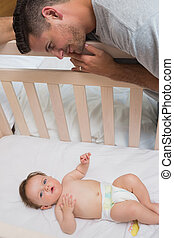 Loving father looking at cute baby - High angle portrait of ...