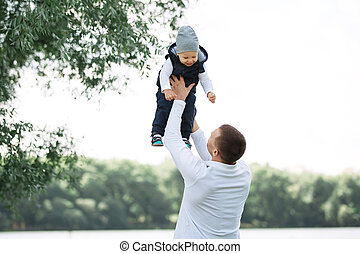 loving father playing with his son outdoors
