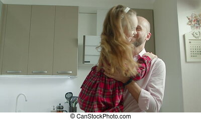 Loving father spinning laughing daugther at home -...
