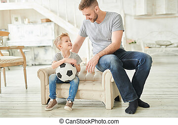 Loving Father Talking to Cute Son