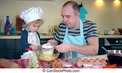 Loving father with her excited cute daughter girl sifting...